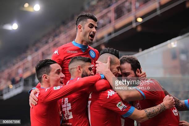 Napoli's midfielder Marek Hamsik from Slovakia celebrates with teammates Napoli's forward from Argentina Gonzalo Higuain Napoli's midfielder from...