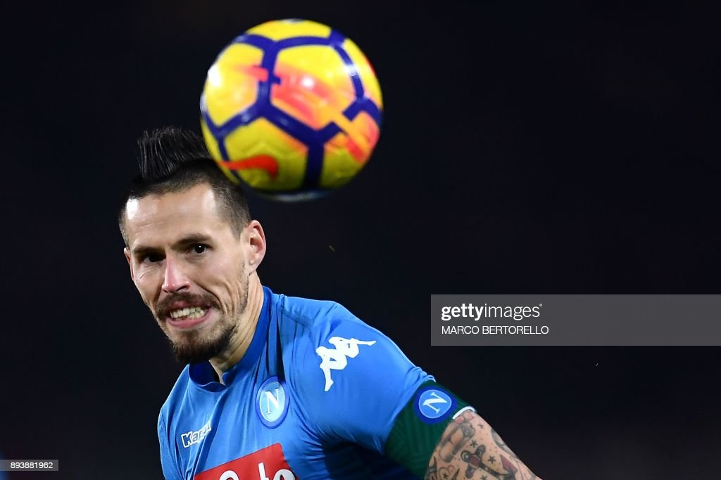 Napoli's midfielder Marek Hamsik from Slovakia eyes the ball during the Italian Serie A football match Torino Vs Napoli on December 16, 2017 at the 'Grande Torino' stadium in Turin. Marek Hamsik equalled Diego Maradona's record as Napoli's all-time top goalscorer as they took advantage of Inter Milan's first defeat of the season and moved top of Serie A with a 3-1 win at Torino. /