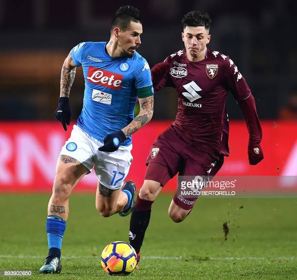 Napoli's midfielder Marek Hamsik from Slovakia fights for the ball with Torino's midfielder Daniele Baselli during the Italian Serie A football match...
