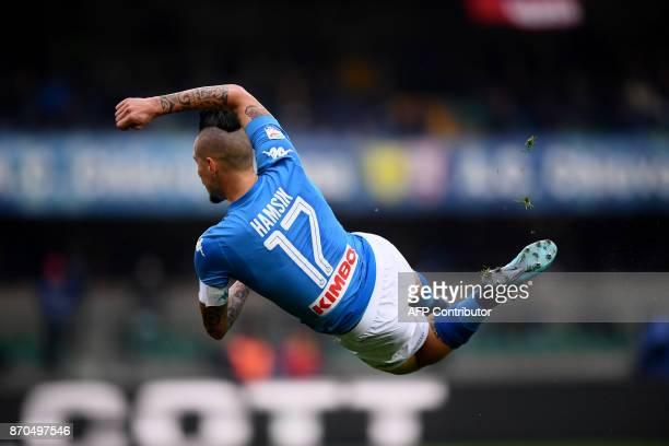 TOPSHOT Napoli's midfielder Marek Hamsik from Slovakia jumps during the Italian Serie A football match Chievo Verona Vs Napoli on November 5 2017 at...