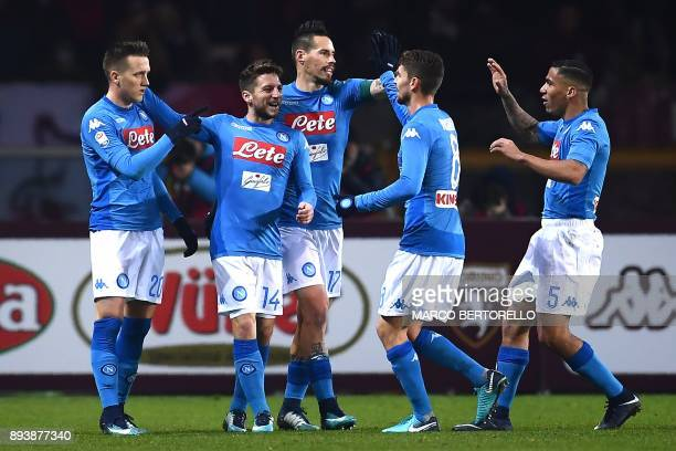 Napoli's midfielder Piotr Zielinski of Poland celebrates with teammates after scoring during the Italian Serie A football match Torino Vs Napoli on...