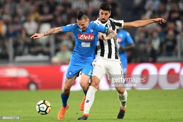 Napoli's midfielder Slovakian Marek Hamsik vies with Juventus' German midfielder Sami Khedira during the Italian Serie A football match between...