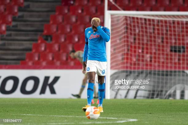 Napoli's Nigerian forward Victor Osimhen reacts during the UEFA Europa League round of 32 first leg football match between Granada FC and Napoli at...