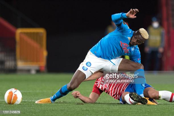 Napoli's Nigerian forward Victor Osimhen vies with Granada's Spanish defender German Sanchez during the UEFA Europa League round of 32 first leg...
