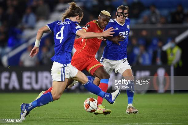 Napoli's Nigerian forward Victor Osimhen vies with Leicester City's Turkish defender Caglar Soyuncu and Leicester City's Belgian defender Timothy...