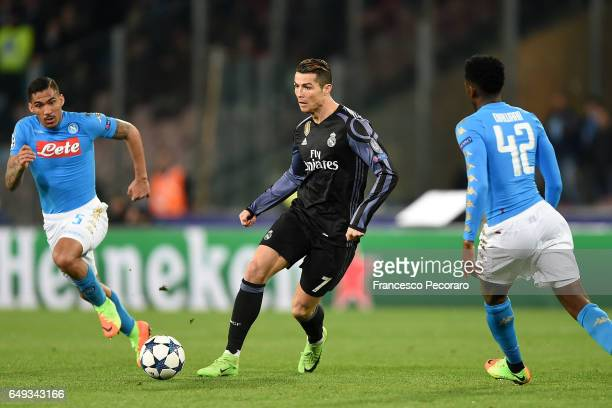 Napolis player Allan vies with Real Madrid CF player Cristiano Ronaldo during the UEFA Champions League Round of 16 second leg match between SSC...