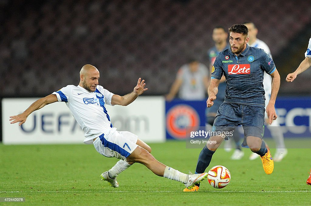 Napoli's player David Lopez vies with FC Dnipro Dnipropetrovsk player Jaba Kankava during the UEFA Europa League Semi Final between SSC Napoli and FC Dnipro Dnipropetrovsk on May 7, 2015 in Naples, Italy.