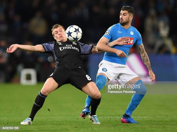 Napolis player Elsied Hysaj vies with Real Madrid CF player Toni Kroos during the UEFA Champions League Round of 16 second leg match between SSC...