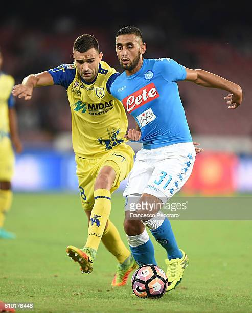 Napolis player Faouzi Ghoulam vies with AC ChievoVerona player Ivan Radanovic during the Serie A match between SSC Napoli and AC ChievoVerona at...