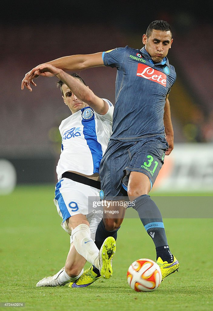 Napoli's player Faouzi Ghoulam vies with FC Dnipro Dnipropetrovsk player Nikola Kalinic during the UEFA Europa League Semi Final between SSC Napoli and FC Dnipro Dnipropetrovsk on May 7, 2015 in Naples, Italy.