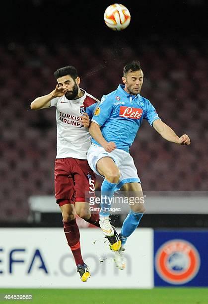 Napoli's player Giandomenico Mesto Mehmet Ekici vies with Trabzonspor player Carl Medjani during the UEFA Europa League Round of 32 football match...