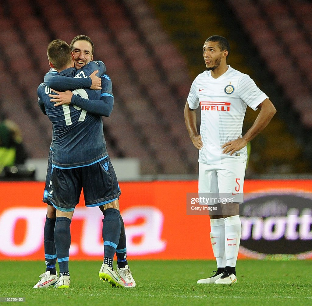 Napoli's player Gonzalo Higuain and David Lopez celebrates after scoring the 1-0 goal , beside the disappointment of Juan Jesus player of FC Internazionale during the TIM CUP match between SSC Napoli and FC Internazionale at the San Paolo Stadium on February 4, 2015 in Naples, Italy.