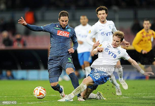 Napoli's player Gonzalo Higuain Tomas Hubokan vies with FC Dinamo Moskva player Aleksei Ionov during the UEFA Europa League Round of 16 football...