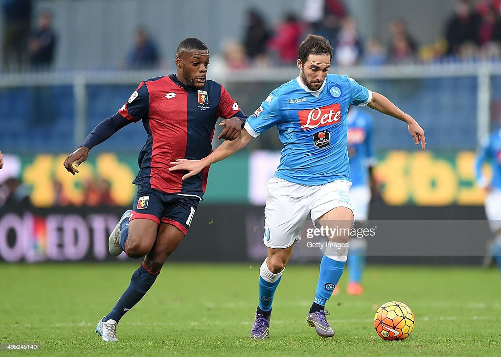 Napoli's player Gonzalo Higuain vies with Genoa player Olivier Ntcham during the Serie A match between Genoa CFC and SSC Napoli at Stadio Luigi Ferraris on November 1, 2015 in Genoa, Italy.