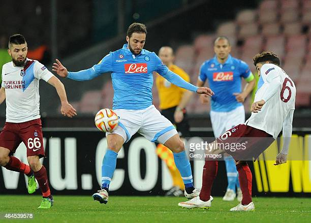 Napoli's player Gonzalo Higuain vies with Trabzonspor player Carl Medjani during the UEFA Europa League Round of 32 football match between SSC Napoli...