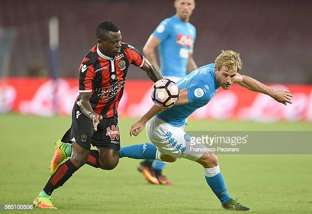 Napoli's player Ivan Strinic vies with OGC Nice player Jean Seri during the preseason friendly match between SSC Napoli and OGC Nice at Stadio San...