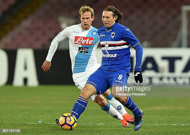 Napolis player Ivan Strinic vies with UC Sampdoria player Edgar Osvaldo Barreto during the Serie A match between SSC Napoli and UC Sampdoria at...