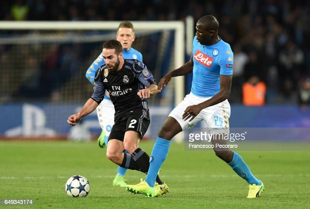 Napolis player Kalidou Koulibaly vies with Real Madrid CF player Dani Carvajal during the UEFA Champions League Round of 16 second leg match between...