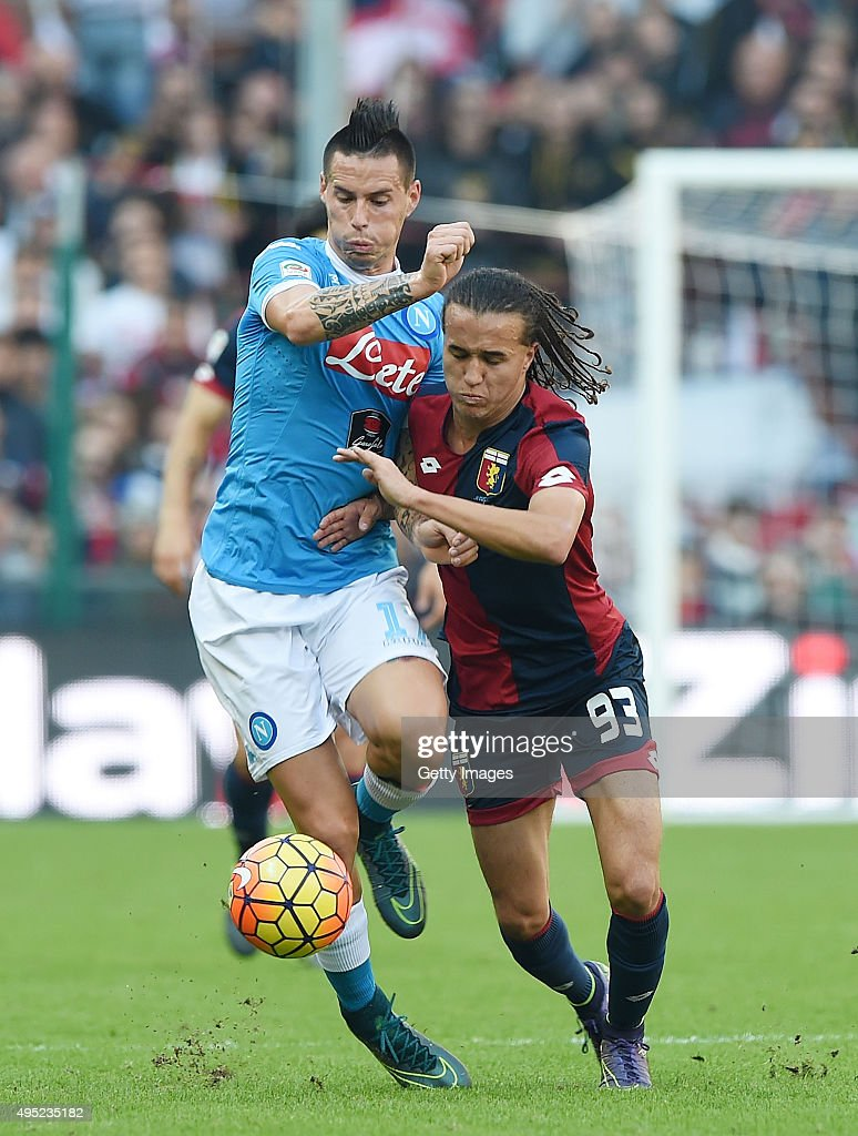 Napoli's player Marek Hamsik vies with Genoa player Diego Lexalt during the Serie A match between Genoa CFC and SSC Napoli at Stadio Luigi Ferraris on November 1, 2015 in Genoa, Italy.