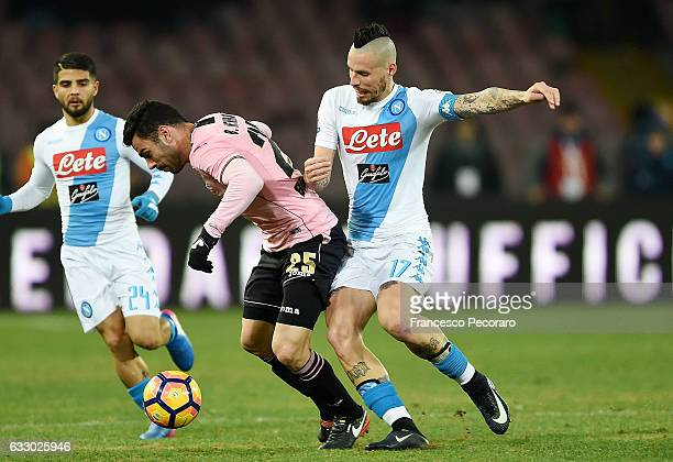 Napolis player Marek Hamsik vies with US Citta di Palermo player Bruno Henrique during the Serie A match between SSC Napoli and US Citta di Palermo...