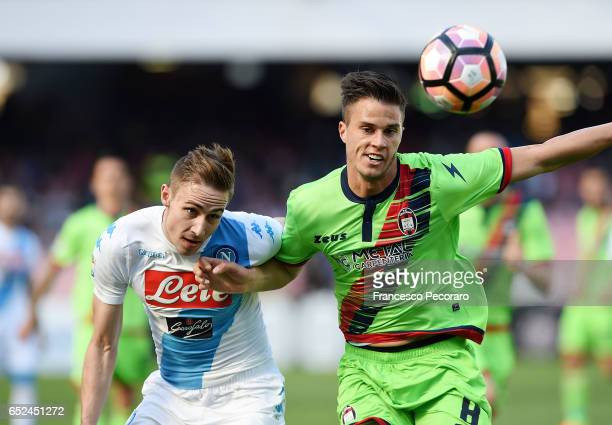Napoli's player Marko Rog vies with FC Crotone player Lorenzo Crisetig during the Serie A match between SSC Napoli and FC Crotone at Stadio San Paolo...