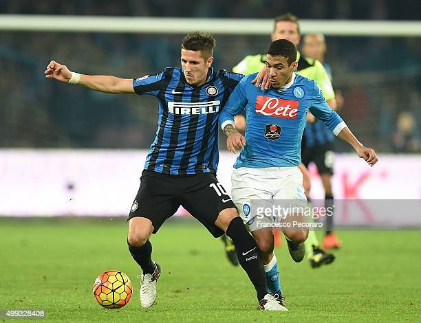 Napoli's player Marques Loureiro Allan vies with FC Internazionale Milano player Stevan Jovetic during the Serie A match between SSC Napoli and FC...