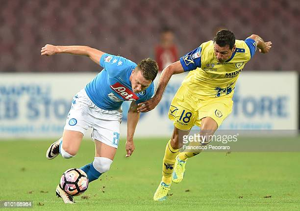 Napolis player Piotr Zielinski vies with AC ChievoVerona player Massimo Gobbi during the Serie A match between SSC Napoli and AC ChievoVerona at...