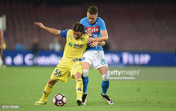 Napolis player Piotr Zielinski vies with AC ChievoVerona player Perparim Hetemaj during the Serie A match between SSC Napoli and AC ChievoVerona at...