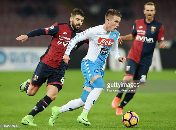 Napolis player Piotr Zielinski vies with Genoa CFC player Miguel Veloso during the Serie A match between SSC Napoli and Genoa CFC at Stadio San Paolo...