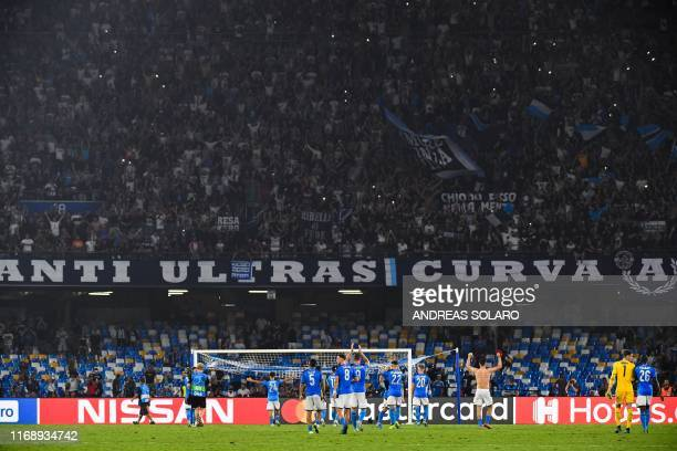 Napoli's players acknowledges fans at the end of the UEFA Champions League Group E football match Napoli vs Liverpool on September 17 2019 at the San...