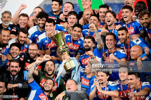 TOPSHOT Napoli's players and staff celebrate after winning the TIM Italian Cup final football match Napoli vs Juventus on June 17 2020 at the Olympic...