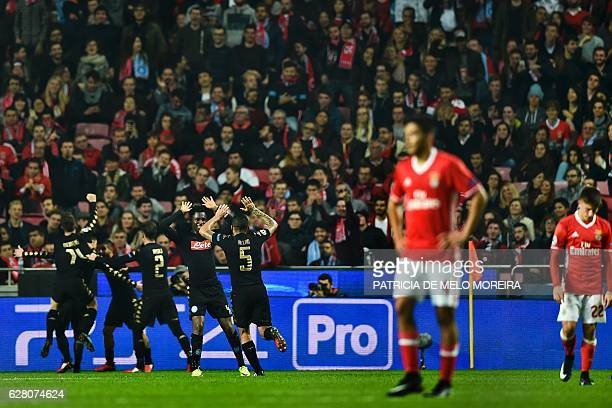 Napoli's players celebrate after Napoli's Spanish forward Jose Callejon scored during the UEFA Champions League Group B football match SL Benfica vs...