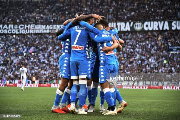 TOPSHOT Napoli's players celebrate after opening the scoring during the Italian Serie A football match Juventus vs Napoli on September 29 2018 at the...