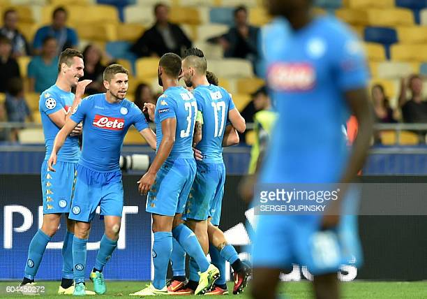 SSC Napoli's players celebrate after scoring a goal during the UEFA Champions League football match between FC Dynamo and SSC Napoli at the...