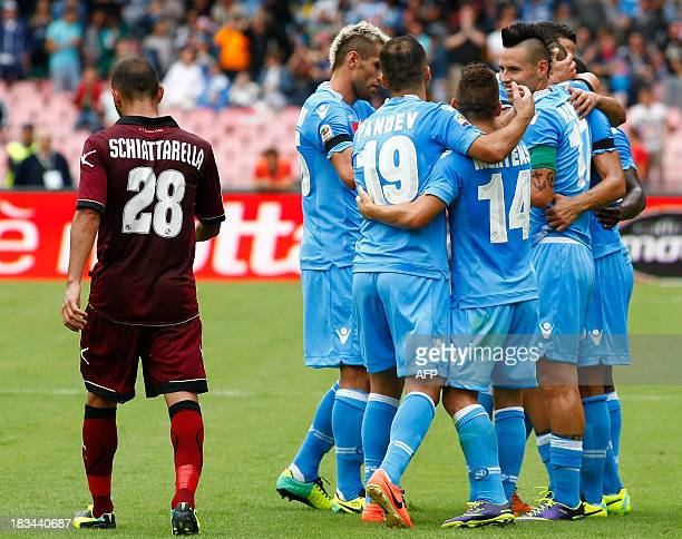 Napoli's players celebrate after scoring during the Italian Serie A football match SSC Napoli vs Livorno at the San Paolo Stadium on October 6 2013...