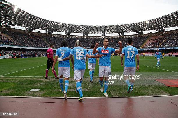 Napoli's players celebrate after scoring during the Serie A football match SSC Napoli vs Pescara Calcio in San Paolo Stadium Naples on December 2...