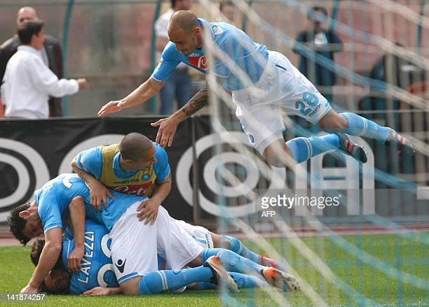 Napoli's players celebrate after Uruguayan forward Edinson Cavani scored during the Italian Serie A football match between SSC Napoli and Calcio...