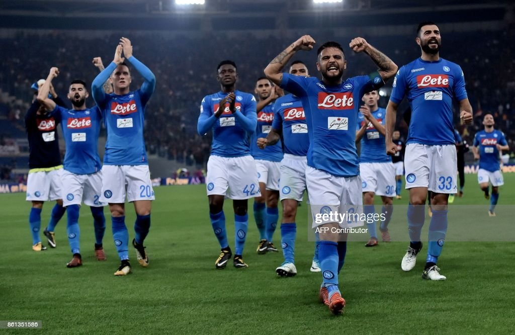 Napoli's players celebrate after winning the Italian Serie A football match Roma vs Napoli at the Olympic Stadium in Rome on October 14, 2017. /