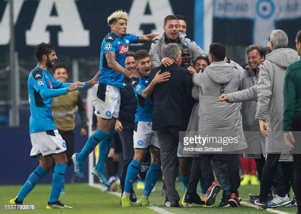 Napoli's players celebrate with coach Carlo Ancelotti after Lorenzo Insigne scored a goal to make it 23 during the champions league group E match...