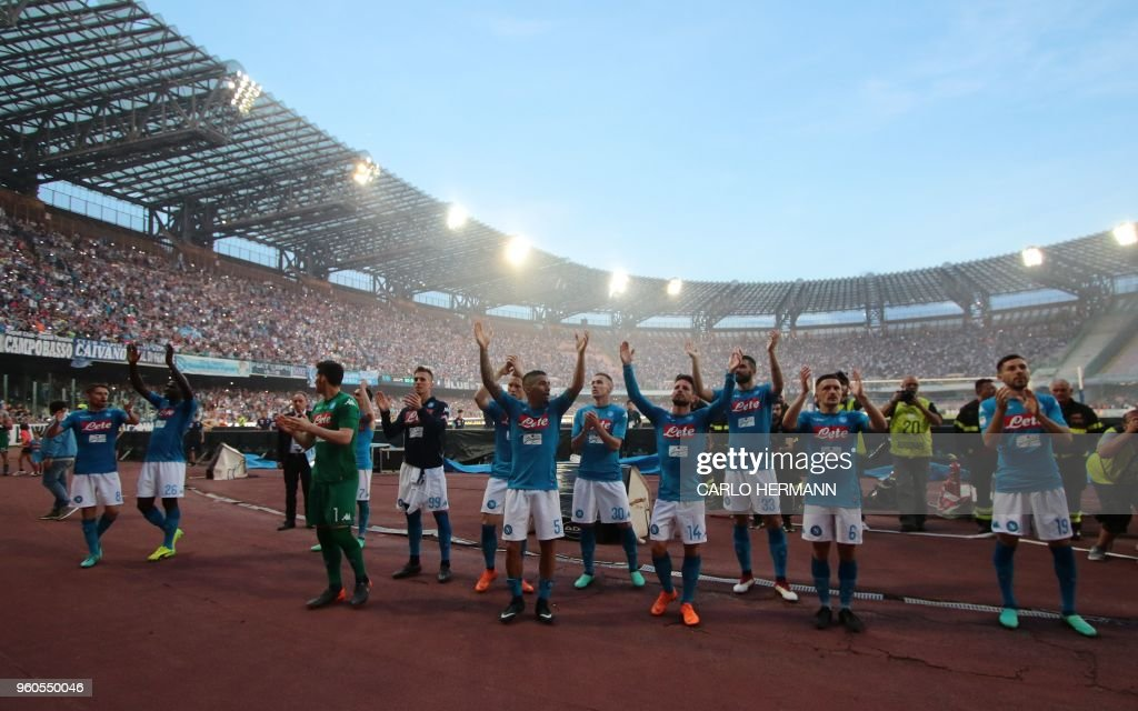 Napoli's players greet fans at the end of the Italian Serie A football match SSC Napoli vs FC Crotone on May 20, 2018 at the San Paolo Stadium.