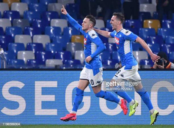 Napoli's Polish defender Piotr Zielinski celebrates after opening the scoring during the Italian Serie A football match Napoli vs Juventus on January...