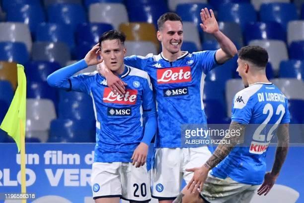 Napoli's Polish defender Piotr Zielinski celebrates with Napoli's Polish forward Arkadiusz Milik and Napoli's Italian defender Giovanni Di Lorenzo...