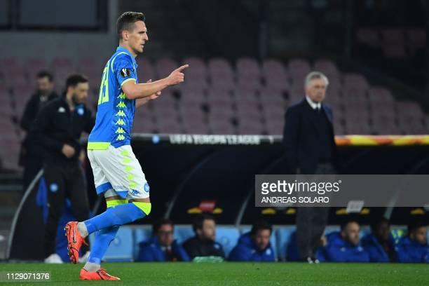 Napoli's Polish forward Arkadiusz Milik celebrates after opening the scoring during the UEFA Europa League round of 16 first leg football match...