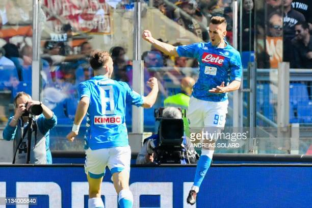 Napoli's Polish forward Arkadiusz Milik celebrates after opening the scoring during the Italian Serie A football match AS Roma vs SSC Napoli on March...