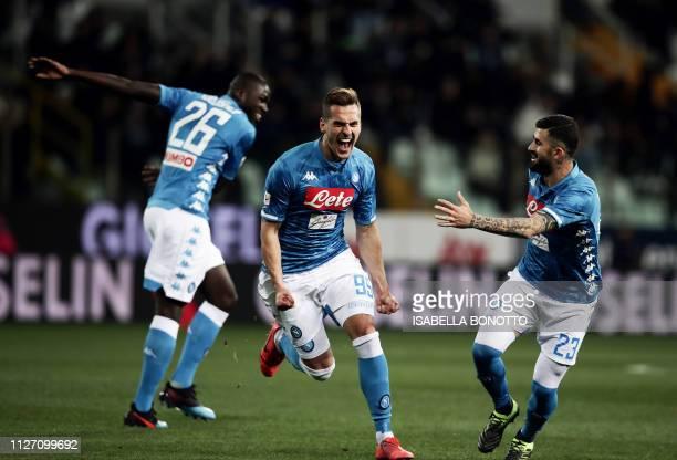 Napoli's Polish forward Arkadiusz Milik celebrates after scoring a goal during the Italian Serie A football match between Parma and Napoli at the...
