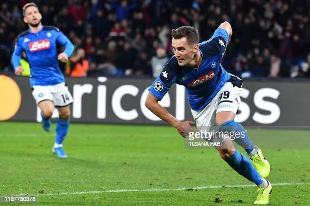 Napoli's Polish forward Arkadiusz Milik celebrates after scoring his second goal during the UEFA Champions League Group E football match Napoli vs...