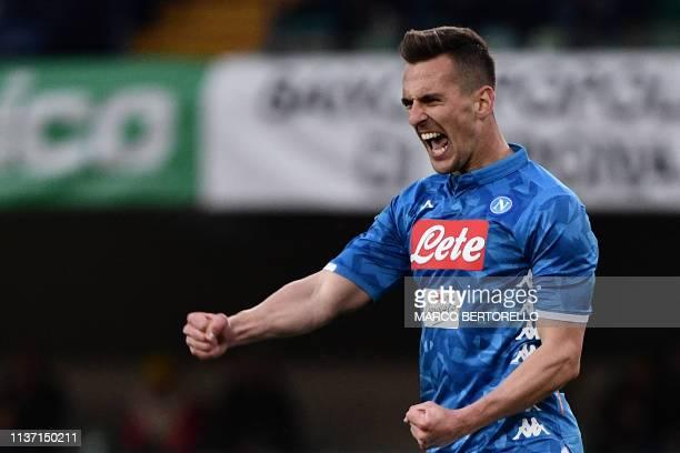 Napoli's Polish forward Arkadiusz Milik celebrates after scoring during the Italian Serie A football match Chievo Verona vs Napoli on April, 2019 at...