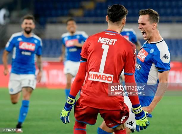 Napoli's Polish forward Arkadiusz Milik celebrates after scoring the winning goal of the penalty shootout for Napoli to win the TIM Italian Cup final...