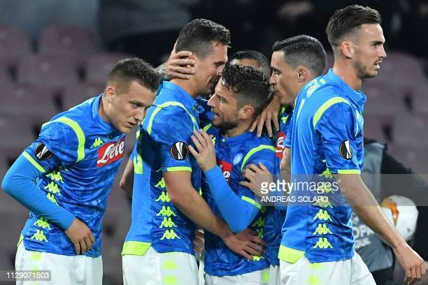 Napoli's Polish forward Arkadiusz Milik celebrates with Napoli's Belgian forward Dries Mertens after opening the scoring during the UEFA Europa...