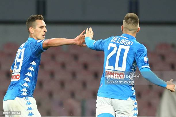 Napoli's Polish forward Arkadiusz Milik celebrates with Napoli's Polish midfielder Piotr Zielinski after scoring during the Italian Serie A football...